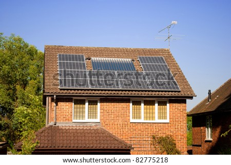 House with solar panels on roof, electricity generation