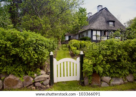 house with thatched roof in the village sieseby in schleswig holstein germany stock photo. Black Bedroom Furniture Sets. Home Design Ideas