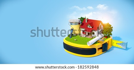 House with the yard and construction equipment on a tape measure. Construction concept