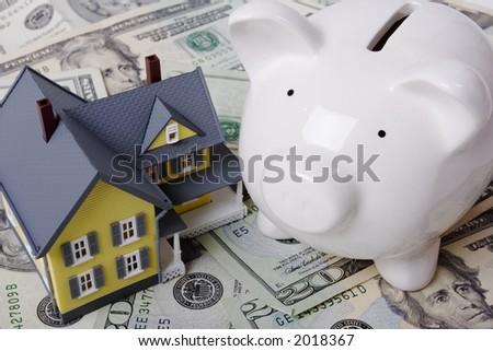 House with twenty dollar bills background and piggy bank
