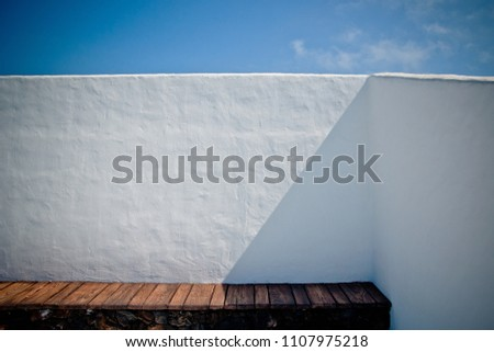 House with white Mediterranean walls with the sea in the background on the islands #1107975218