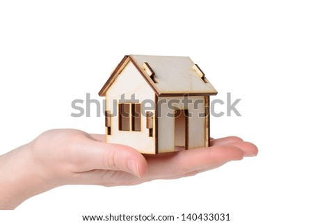 House Wooden in  hand - isolated on white background