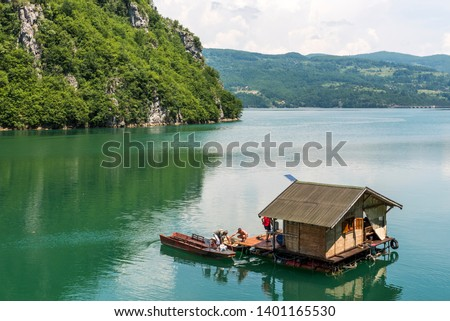 Houseboat (housing on raft) in National Park Tara in Serbia  #1401165530