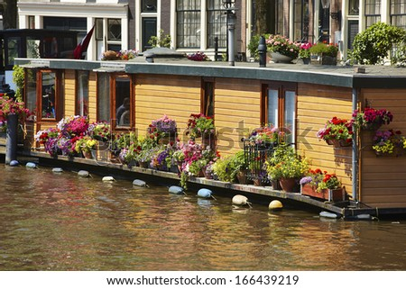 Houseboat with flowers in Amsterdam, The Netherlands,