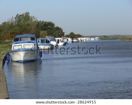 houseboats moored on the river bure on the norfolk broads