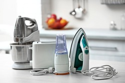 Household and kitchen appliances on the table in kitchen