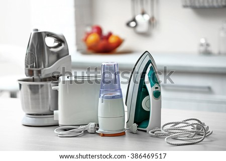 Household and kitchen appliances on the table in kitchen #386469517
