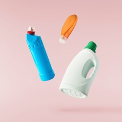 Household cleaning product. A plastic bottle falling in the air isolated on pink background. Product mockup for your brand