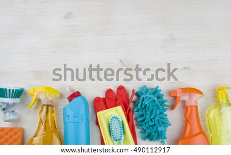 Household cleaning products on wooden background with copyspace at top #490112917