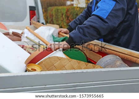 Household clearance, the household contents are placed in a trailer  #1573955665