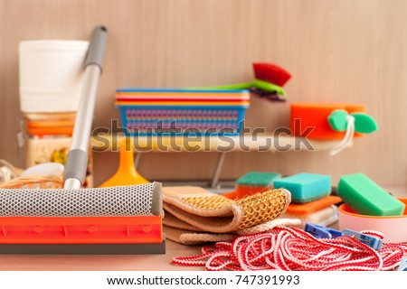 Household items. Household goods are collected in a heap. An ironing board, a clothesline, clothespins, toilet paper, plastic boxes, a brush for glasses, sponges for utensils are household utensils. #747391993