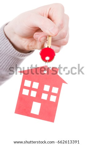 Household ownership security real estate symbolism concept. Key ring with house pendant. Home symbol held by human hand. #662613391