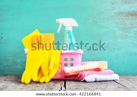 Household supplies and cleaning on wooden table.