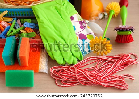 Household trivia. Rubber gloves, a clothesline, clothespins, a brush for ware, a paralon sponge are the economic goods. Household items for household use. #743729752