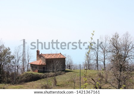 houses and structures built and then left abandoned in the isolation of nature high up in the hills in Tuscany #1421367161