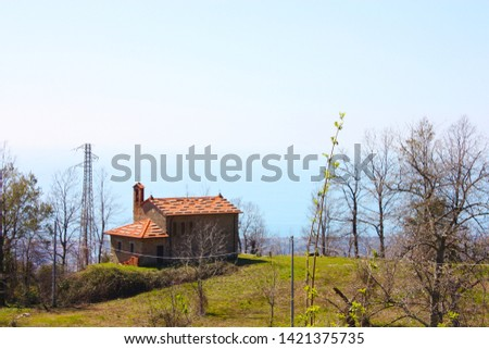 houses and structures built and then left abandoned in the isolation of nature high up in the hills in Tuscany #1421375735