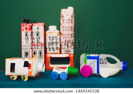 Houses and toy cars made from milk bags. DIY paper milk bag. Creative paper milk bag ideas. Recycle crafts.