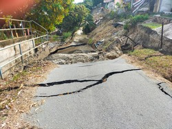 Houses collapsed and roads cracked down as a result of landslides. A landslide is defined as the movement of a mass of rock, debris, or earth down a slope. Soil Settlement due o earth movement.