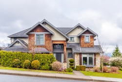 Houses in suburb with Spring Blossom in the north America. Luxury houses with nice  landscape.