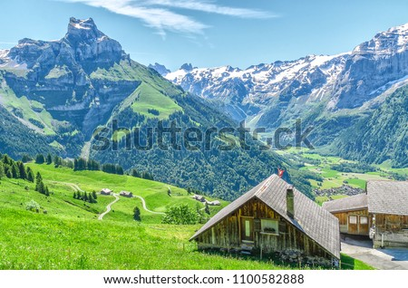 Houses in the Swiss village of the Engelberg resort. Landscape of Swiss alpine nature\r