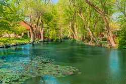 Houses line a small pond area of Lake Ransom Canyon in Texas. The little secret nook looks idyllic in it's seclusion and beauty.