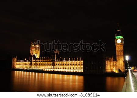 Houses of Parliament and big ben seen at night across the river Thames. London, UK