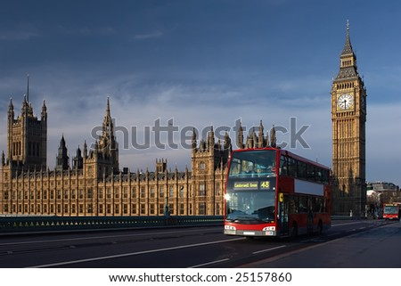 Houses of Parliament with Big Ben tower and red bus in London