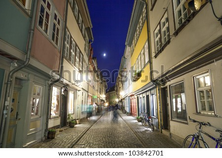 Houses on Kraemerbruecke - Merchants Bridge in Erfurt, Germany. Two narrow rows of houses are built along both sides of the bridge.