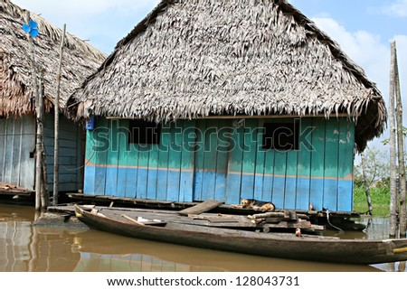 Houses on stilts rise above the polluted water in Belen, Iquitos, Peru. Thousands of people live here in extreme poverty without clean water or sanitation.