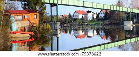Houses on the bank and iron bridge over a Czech Valley Reservoir - Radbuza River- Pilsen City - Czech Republic Europe