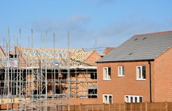 Houses under construction at a modern building site in England, United Kingdom.