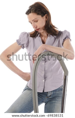 Housewife, cleaning lady with long dark blond hair with the housework with a vacuum cleaner, isolated on a white background.