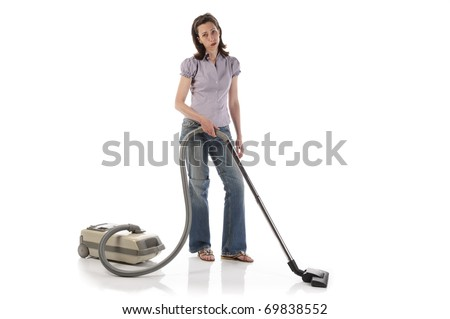 Housewife, cleaning lady with long dark blond hair with the housework with a vacuum cleaner on a white background.