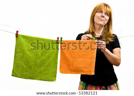 housewife hanging towels on clothesline using clothespin, White background