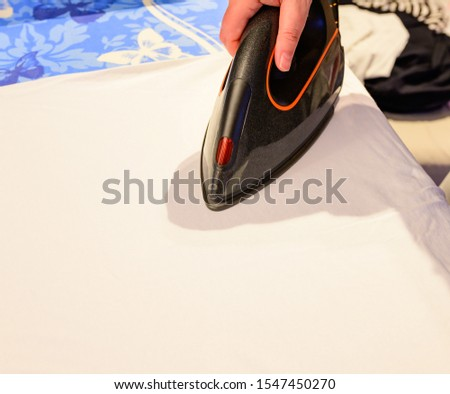 housewife irons washed garments with iron #1547450270