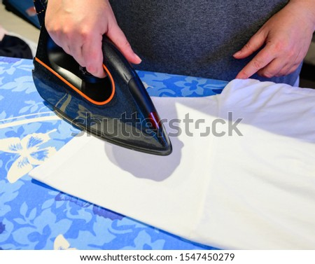 housewife irons washed garments with iron #1547450279