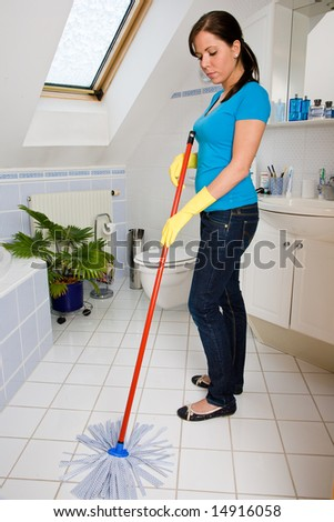 housewife is cleaning her flat
