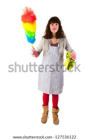 Housewife is cleaning the dust with feather broom