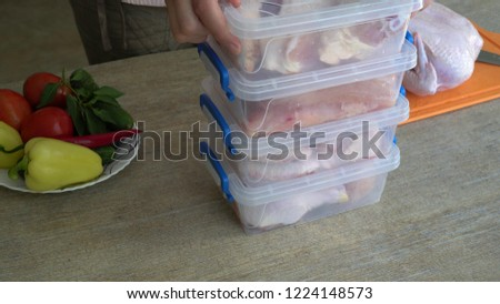 Housewife Portions Out Whole Chicken, And Freeze Pieces In A Separate Container. Chicken: Cutting, Freezing, Storing, Marinating, Cooking at Home