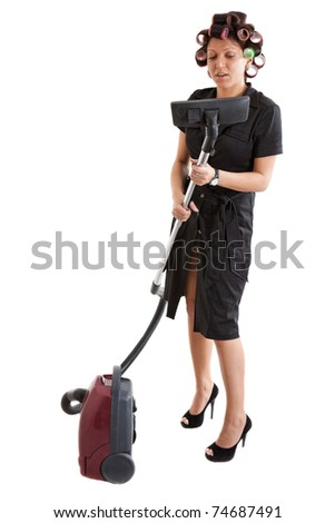 housewife with a vacuum cleaner - stock photo