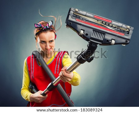 Housewife with vacuum cleaner