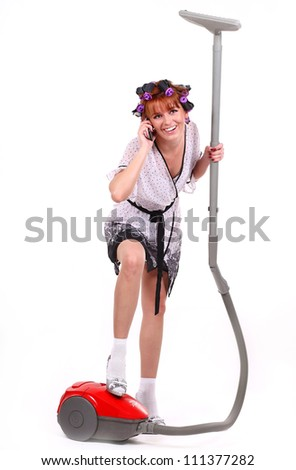 housewife with vacuum cleaner in hand