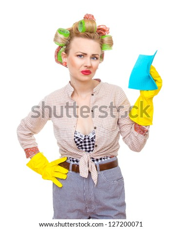Housewife / woman spraying the cleaner on you, isolated on white. Glass or window cleaner