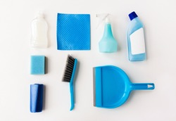 housework, housekeeping and household concept - cleaning stuff on white background