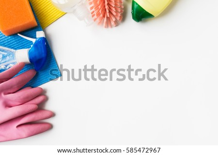 housework, housekeeping and household concept - cleaning stuff on white background stock photo