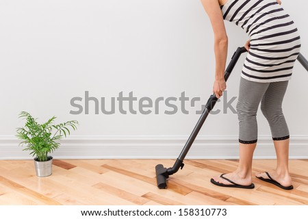 Housework. Young woman vacuum cleaning the apartment.