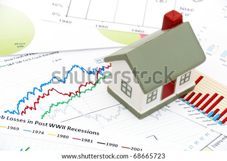 housing market graph. stock photo : Housing market concept image with graph and toy house