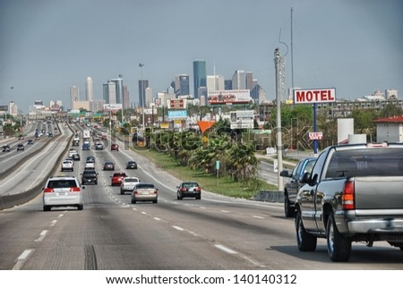 HOUSTON - MAR 15: Cars enter the city, March 15, 2009 in Houston. Traffic is a big city issue in the last years.