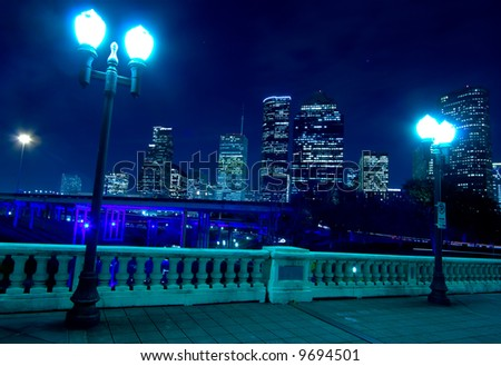 stock-photo-houston-skyline-at-night-with-bridge-in-foreground-9694501.jpg