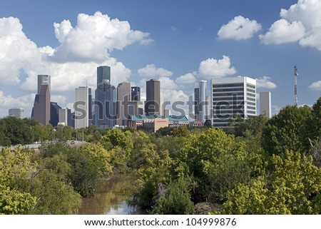 Houston Skyline with a Park and a River in the Foreground.